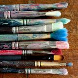 pennelli Colore-macchiati Immagini Stock