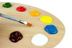 Pennelli, colori e pallet Immagine Stock