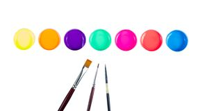 Pennelli e vernice fotografia stock