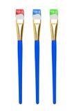 Pennello con vernice variopinta sulla punta Immagini Stock
