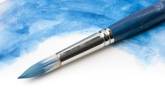 Pennello dell'acquerello su superficie verniciata immagini stock