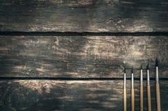 Pennello sul fondo invecchiato del bordo di legno Fotografia Stock
