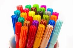 Pennen in een container stock foto