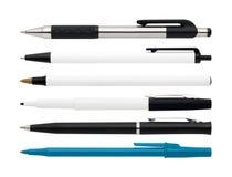 Pennen en een teller Stock Foto