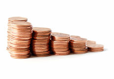 Pennies. Stacks of pennies against a white background Stock Photo