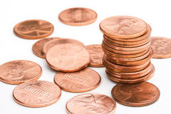 Pennies. A stack of pennies on a white background royalty free stock photos