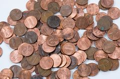Pennies from Heaven. Pennies randomly spread out on a white background Royalty Free Stock Photography