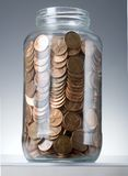 Pennies in jar Royalty Free Stock Photo