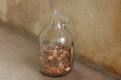 Pennies in a jar. Pennies in a gallon jug Royalty Free Stock Photos