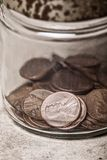 Pennies in a Jar Royalty Free Stock Images