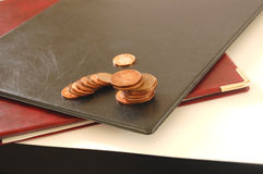 Pennies to save. This is an image of some portfolios with a stack of pennies on them royalty free stock image