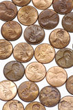 Pennies on White Background. Vertical Pennies Laid Out on a White Background Stock Images