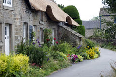 Pennine Cottage. Thatched stone cottages with flowers in pretty Pennine village stock photo