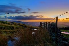 The Pennine Way along the backbone of England. Strikingly beautiful sunset view towards Manchester from an English Pennine hilltop Royalty Free Stock Image