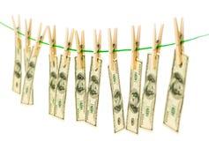 Penningtvättbegrepp med dollar Arkivbild