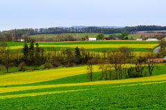 Pennsylvania countryside and farms in spring near Kutztown. Fields just starting to be plowed. Royalty Free Stock Photo