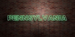 PENNSYLVANIA - fluorescent Neon tube Sign on brickwork - Front view - 3D rendered royalty free stock picture Stock Image