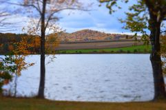 Pennsylvania by the lake on an autumn day in October. Fall foliage on the mountains in Pennsylvania by the lake on an October afternoon Royalty Free Stock Photos