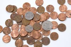 Penny avec de l'argent mélangé dedans. Photo libre de droits