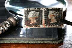 Penny Black. Horizontal pair of plate 1b Penny Black with red Maltese cross cancellation. It is the world`s first adhesive postage stamp stock images