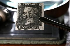 Penny Black. Horizontal pair of plate 1b Penny Black with red Maltese cross cancellation. It is the world`s first adhesive postage stamp stock image