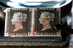 Penny Black. Horizontal pair of plate 1b Penny Black with red Maltese cross cancellation. It is the world`s first adhesive postage stamp stock photography