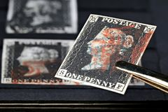 Penny Black. Horizontal pair of plate 1b Penny Black with red Maltese cross cancellation. It is the world`s first adhesive postage stamp stock photos