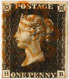 Penny Black with red postmark. 1840 Penny Black with a red Maltese Cross postmark stock images