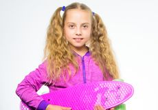 Penny board of her dream. Best gift for kid. Kid long hair carry penny board. Plastic skateboards for everyday skater. Child hold penny board. Choose royalty free stock photo