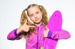 Penny board of her dream. Choose skateboard that looks great and also rides great. Best gift for kid. Kid long hair. Carry penny board. Plastic skateboards for stock photography