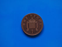 1 penny coin, United Kingdom over blue Stock Images
