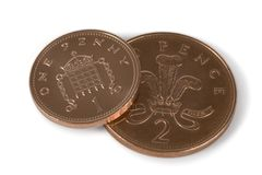Penny Coins. English coins isolated over a white background with clipping path stock image