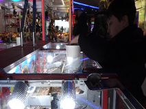 A penny falls game in an amusement arcade stock video