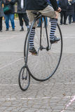 Penny-farthing bicycle in a park Stock Photography