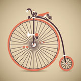 Penny Farthing Bicycle. Vintage penny farthing high wheel bicycle on beige background Royalty Free Stock Images