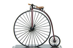 Penny Farthing Historical bicycle. Model with a white background. The penny-farthing, also known as the high wheel, high wheeler or ordinary, is a type of stock photo