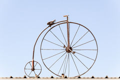 Penny Farthing. Side view of penny farthing against a blue sky stock images