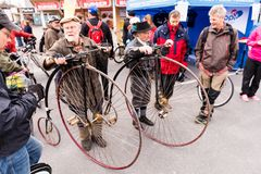 Penny Farthings at Tammelantori in Tampere. A pair of men with classic penny-farthing bikes on Tammelantori at the start of the annual bicycling week on 5.5.2018 Stock Photo