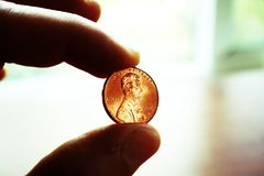 Penny In Hand Close Up With Lomo Effect High Quality. Stock Photo Royalty Free Stock Photos