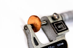 Penny in a micrometer guage to measure thickness Royalty Free Stock Photo