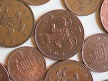 Penny and Pence coins, United Kingdom. One Penny and Two Pence Pound coins money (GBP), currency of United Kingdom, soon to be withdrawn, possibly stock photography