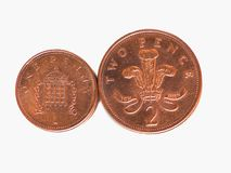 Penny and Pence coins, United Kingdom. One Penny and Two Pence Pound coins money (GBP), currency of United Kingdom, soon to be withdrawn, possibly stock photos