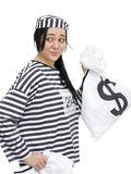 Penny Pincher. A Case Of Cash And Carry As A Felon Looks Over Her Shoulder In The Process Of Penny Pinching Royalty Free Stock Photos