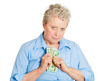 Penny pinching older woman Stock Photo