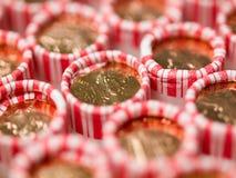 Penny Rolls ausgerichtet in einem Kasten Stockfotos
