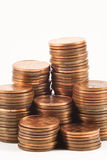 Penny Stacks. Stacks of pennies on white background Royalty Free Stock Photo