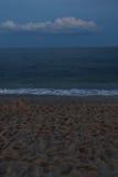Penombra all'oceano con la nuvola Fotografia Stock