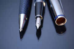 Pens. Classic nibbed fountain pen, on dark background royalty free stock image