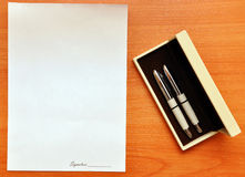 Pens and blank paper for signature Royalty Free Stock Photo