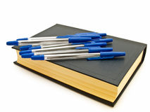 Pens at the book royalty free stock photo